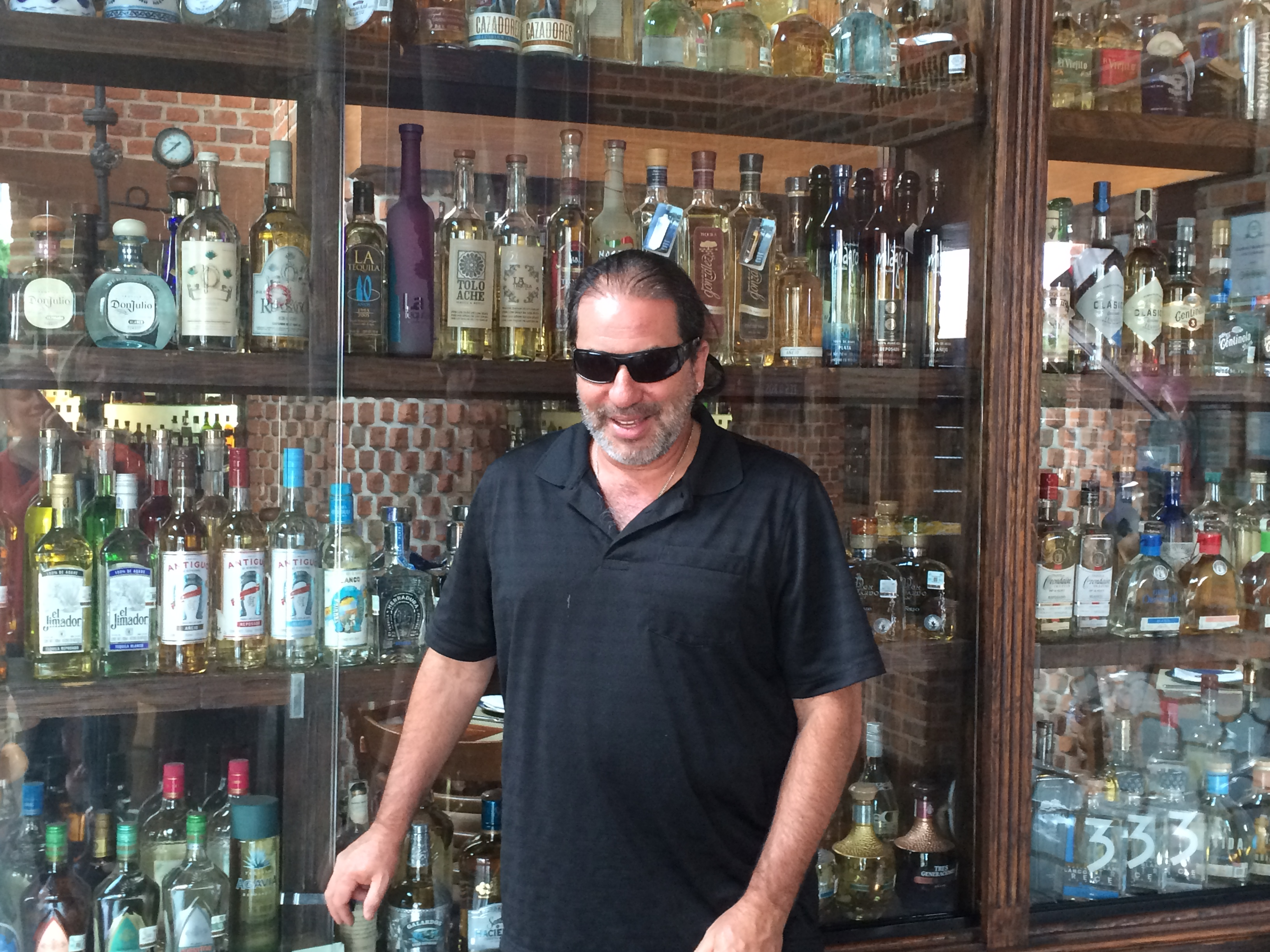 Alan in front of all the tequila at LaTequila